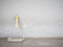 Paint roller with the old concrete wall Stock Photos