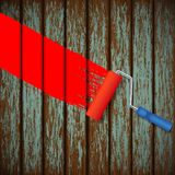 Paint roller and an old wooden fence Stock Photography