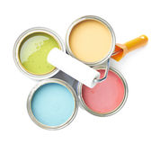 Paint roller over cans of paint Royalty Free Stock Photography