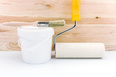 Paint roller with paint can and brush Stock Image