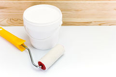 Paint roller with paint can Stock Image
