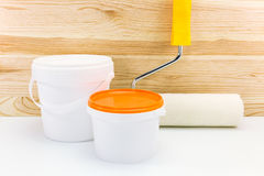Paint roller with paint cans ready for use Stock Images