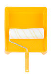 Paint roller in paint tray. Paint roller in yellow paint tray over isolated white background Stock Image