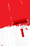 Paint roller - painting the walls red Royalty Free Stock Photography