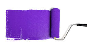 Paint Roller With Purple Paint royalty free stock images