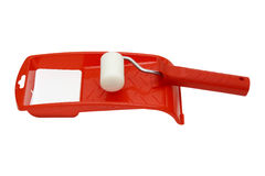 Paint roller and red tray Stock Photos