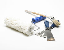 Paint roller, spatulas and paintbrush Royalty Free Stock Photos