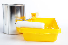 Paint roller, tray, and jar with paint Royalty Free Stock Photo