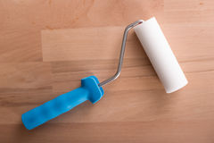 Paint-roller on wooden table Stock Photo