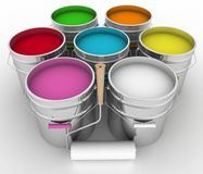 Paint and rollers. Open buckets with a paint and rollers Royalty Free Stock Photo