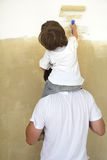 Paint room. Father and son paint room stock image