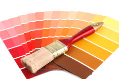 Paint Samples. Multi colored paint samples and a paint brush Stock Photo
