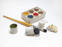 Paint set and brush in the paint. Paint set and brush in black paint Royalty Free Stock Image