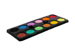 Paint set over white. Isolated painting kit with many colors in a black palette Stock Photo