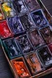 Paint slots closeup. Closeup shot of various used pain slots Stock Image