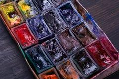 Paint slots closeup. Closeup shot of various used pain slots Royalty Free Stock Photos