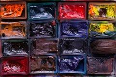Paint slots closeup. Closeup shot of various used pain slots Royalty Free Stock Images
