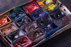 Paint slots closeup. Closeup shot of various used pain slots Stock Photo