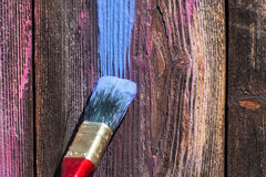 Paint smear on wooden background Stock Photo
