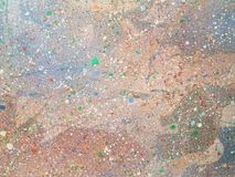 Paint speckles on a surface Stock Photos
