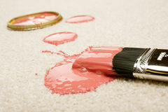 Paint Spill on Carpet. Pink paint spilled on cream coloured carpet with brush Royalty Free Stock Images