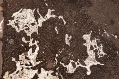 Paint spill on road. Abstract pattern of white paint spilled onto a road Stock Images
