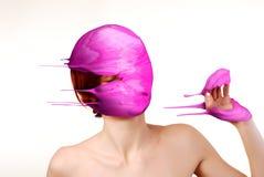 Paint splash. Splash of purple paint on head of woman Stock Photos
