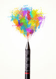 Paint splashes coming out of pen Stock Photos
