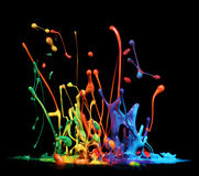 Paint splashing. Colorful paint splashing on black royalty free stock photography