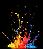 Paint splashing. Colorful paint splashing on black stock photo
