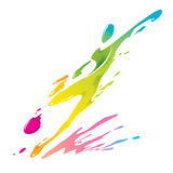 Paint splashing - Soccer player kicks the ball. Multicolored paint splash, shape of a soccer player kicking the ball Royalty Free Stock Photography
