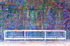 Paint splatter. Ed wall in an art studio, also available in vertical Royalty Free Stock Photos