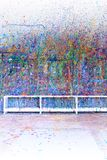 Paint splatter. Ed wall in an art studio, also available in horizontal royalty free stock image