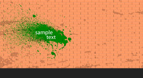 Paint splatter on brick wall. Brick wall with green paint splodge. Paint splatter on brick wall. Inspirational vector background stock illustration