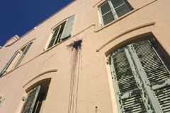 Paint splatter on building. Black paint thrown at historic building in the French Quarter of New Orleans, Lousiana Royalty Free Stock Photography