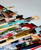Paint splattered art brushes Stock Images