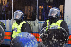 Paint splattered UK riot police,London,UK. Royalty Free Stock Image