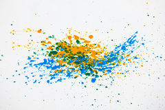 Paint Splatters. Blue, yellow, and green paint splatters on white Stock Image