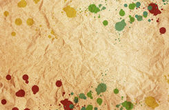 Paint splatters on brown paper Royalty Free Stock Photo