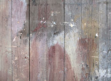 Paint Stained Old Wood Fence. Old splashy paint stained wooden boards fence Royalty Free Stock Image