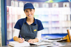 Paint store clerk. Beautiful female paint store clerk working Stock Photography
