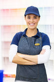 Paint store worker. Portrait of cute female paint store worker royalty free stock photo