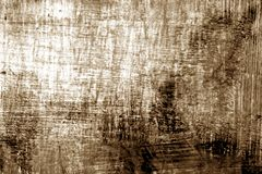 Paint strockes on metal in brown tone. Abstract background and pattern Stock Image