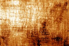 Paint strockes on metal in orange tone. Abstract background and pattern Stock Photos
