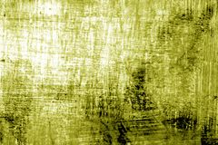 Paint strockes on metal in yellow tone. Abstract background and pattern Stock Photo