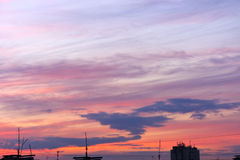 Paint the sunset sky over the city Stock Photo