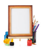 Paint supplies and frame  on white Royalty Free Stock Images