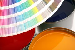 Paint swatch with paint cans. Paint swatch with cans of primary colored paints stock photos