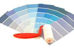 Paint swatches. Blue shade paint swatches, and small paint roller for home decorating Royalty Free Stock Image