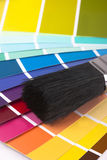 Paint swatches and paintbrush close up stock images